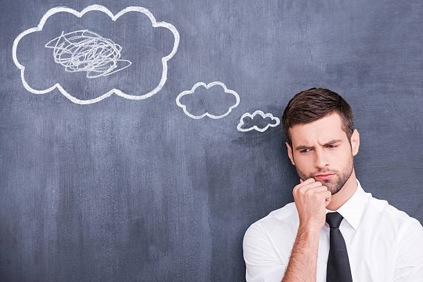 recruitment consultant in front of chalkboard with thought clouds